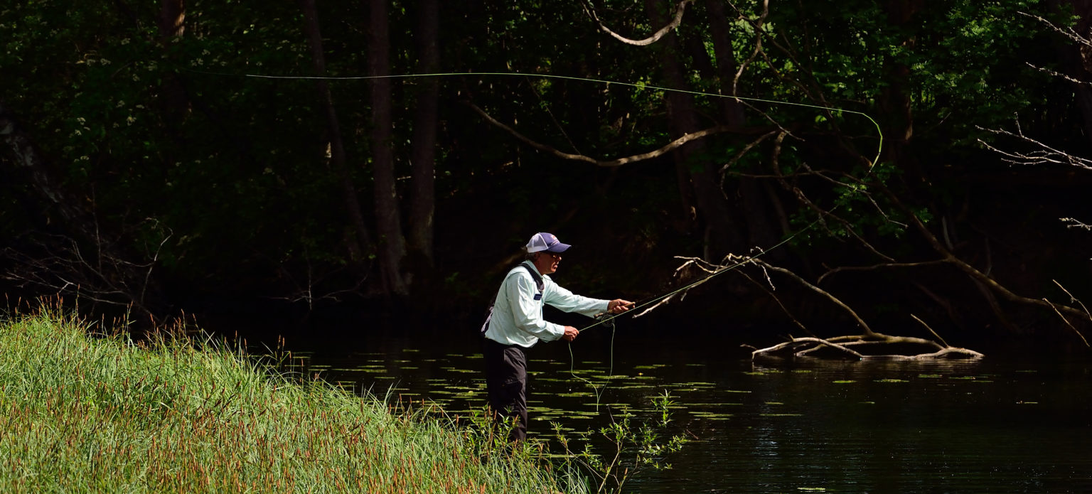 A person throwing the fishing line